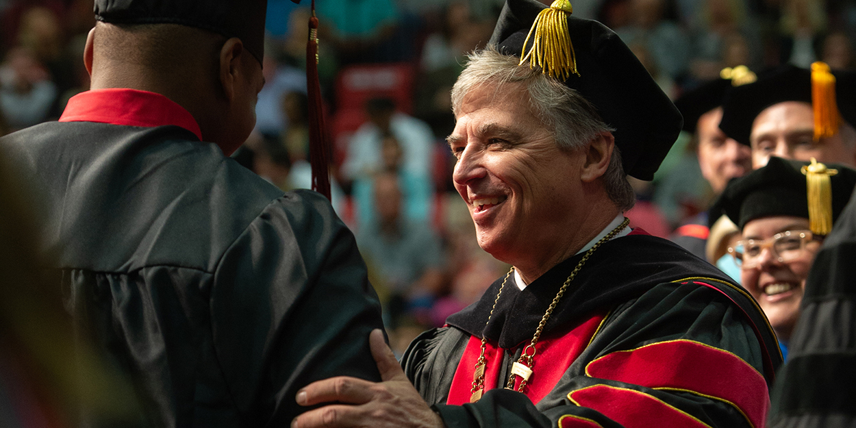 Chancellor Randy Pembrook greets students during commencement exercises.