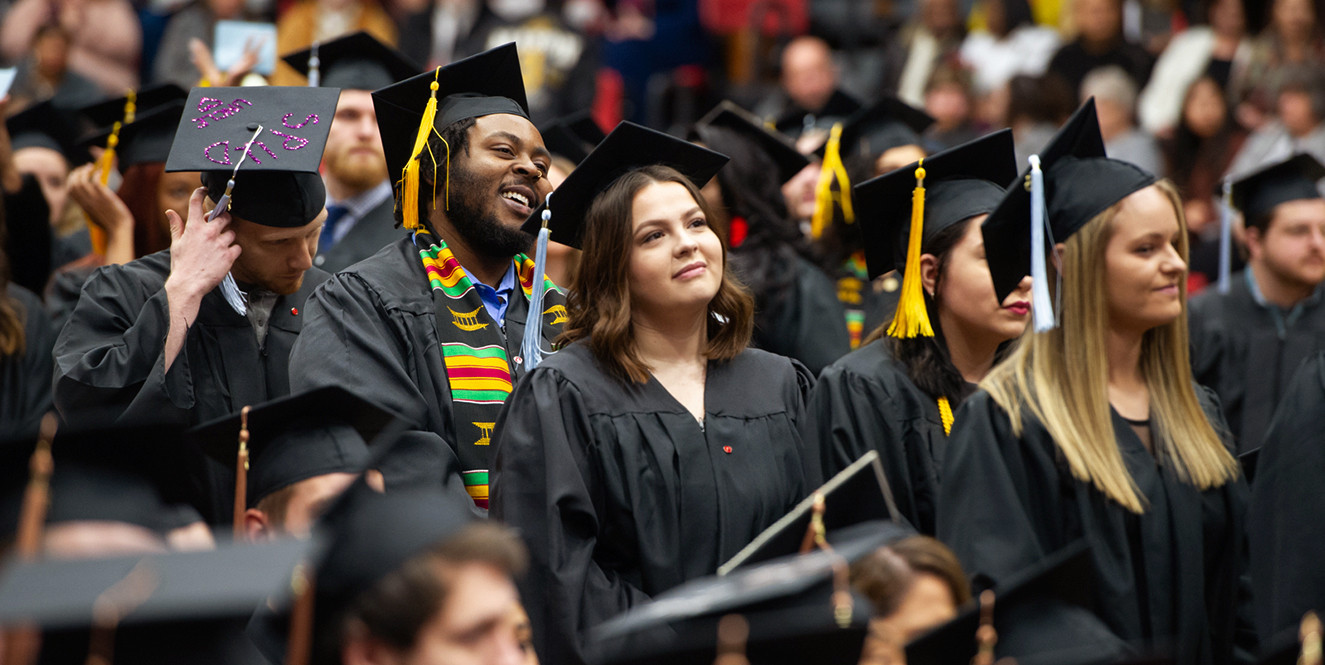 Students listen to a speaker during commencement exercises.