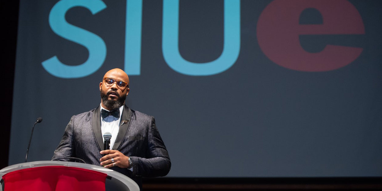 Woman speaking at a podium at SIUE.