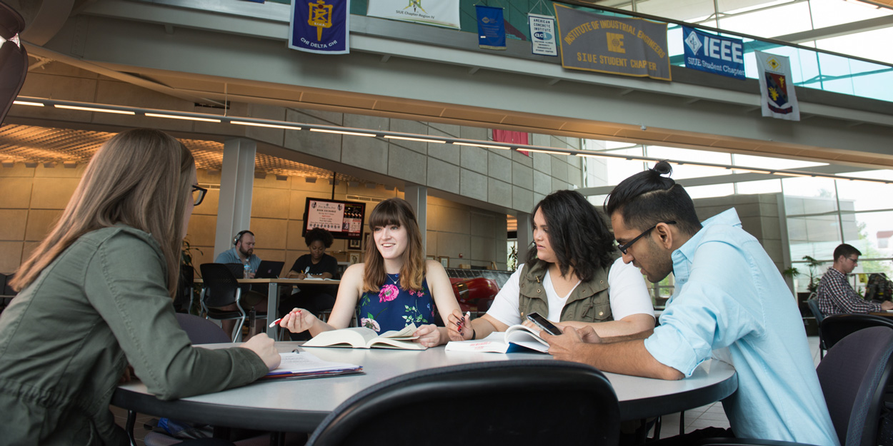 Student working at a table in the Engineering Building at SIUE.