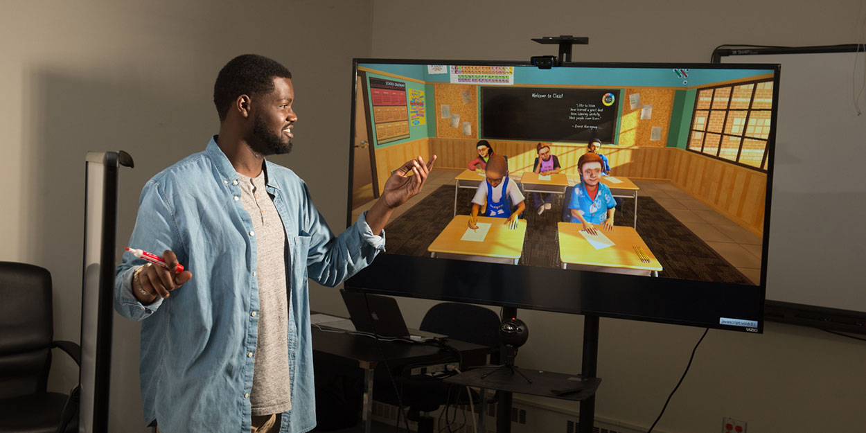 A student practicing teaching in front of a virtual learning environment
