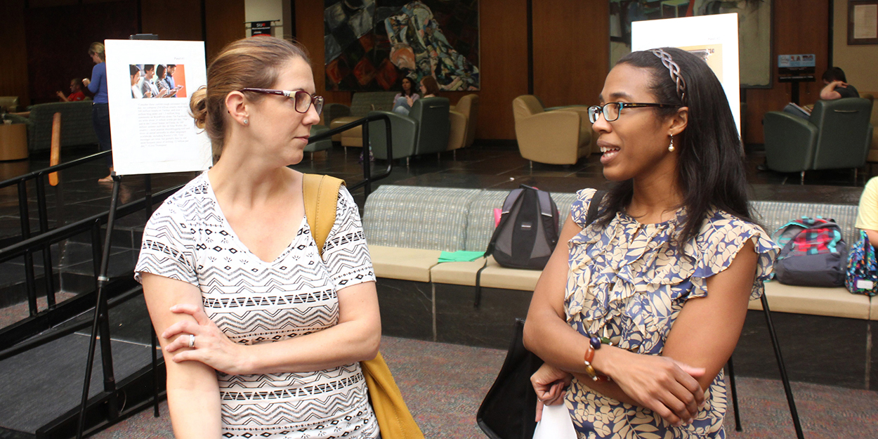 Two faculty members meet in the Goshen Lounge at the Morris University Center.