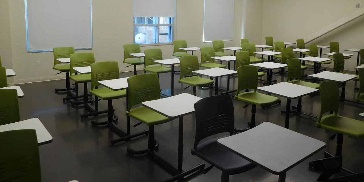 Classroom with green chairs.