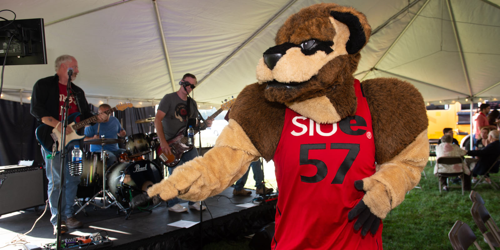 Eddie the Cougar dancing to a band at homecoming.