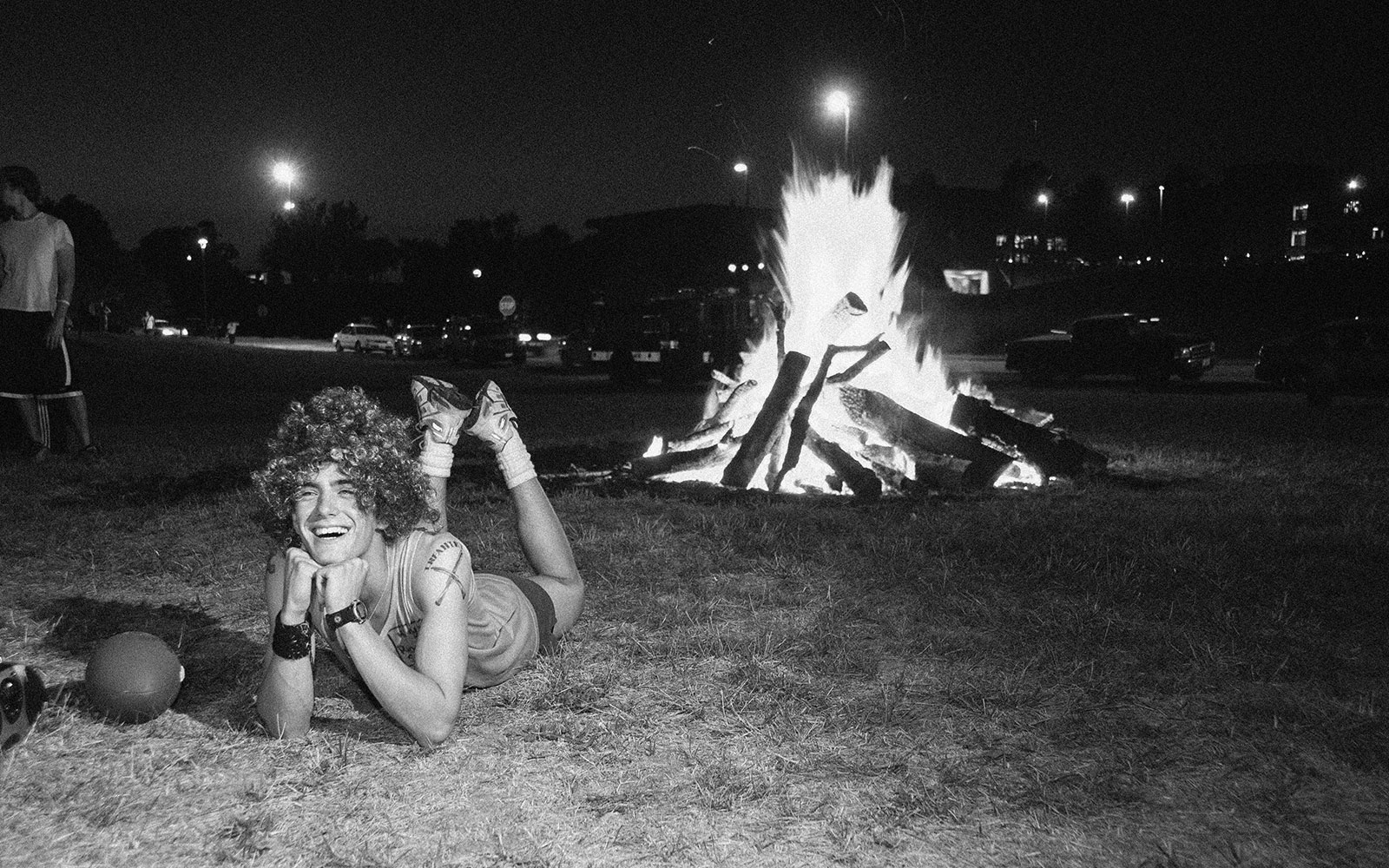 An old photo of an SIUE student at the Homecoming bonfire