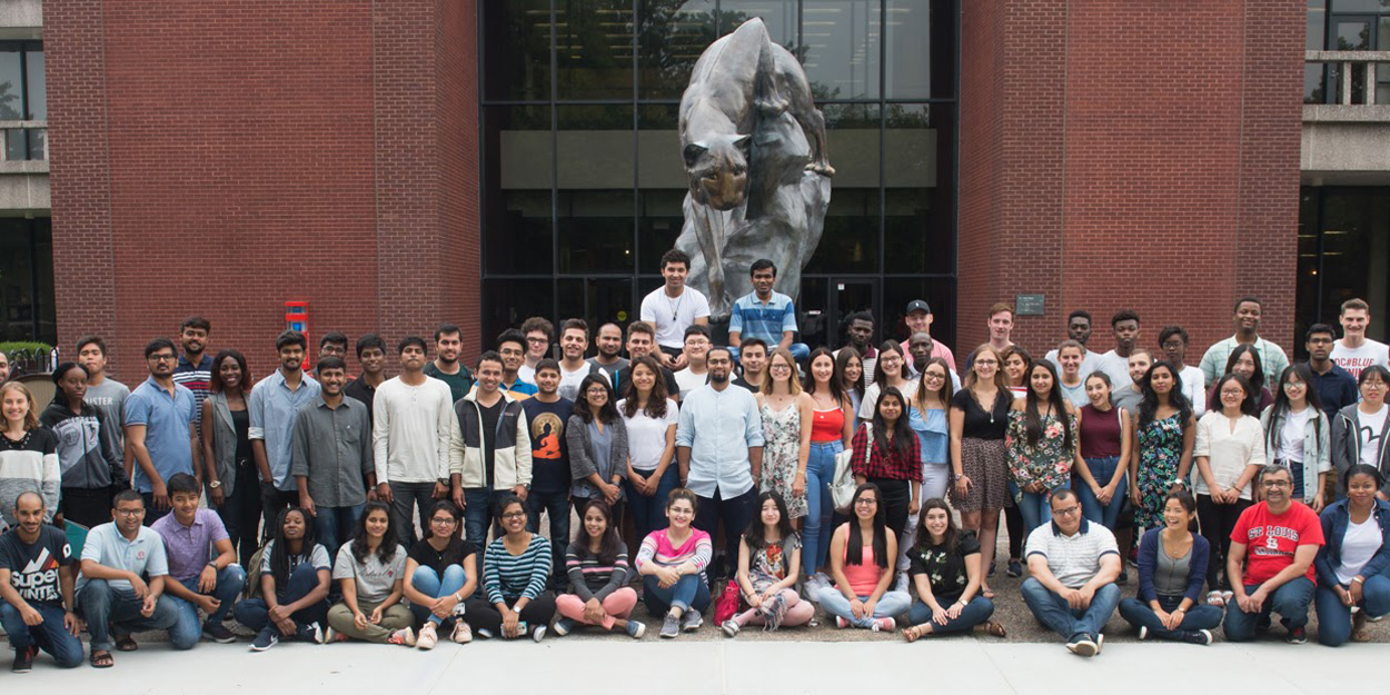 International Students in front of the Cougar Statue.