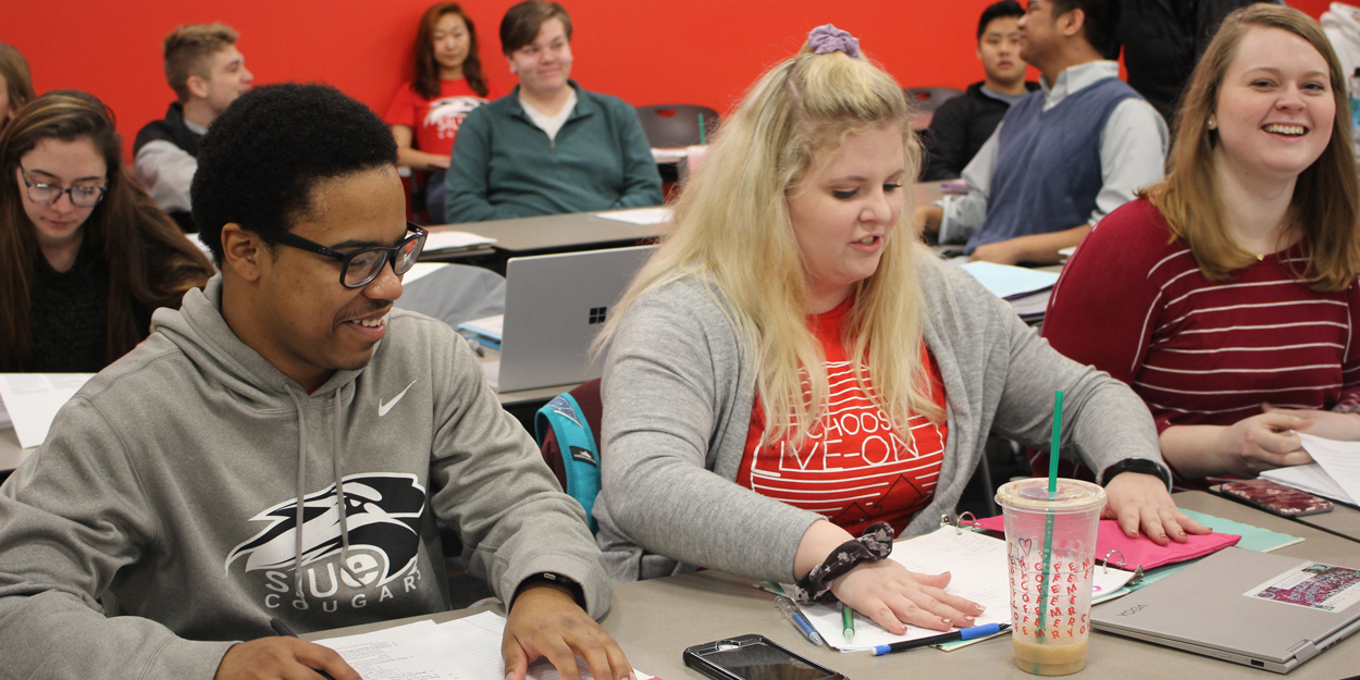 SIUE Students working in a classroom.