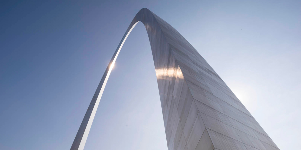 St. Louis Arch with sun shining on it.