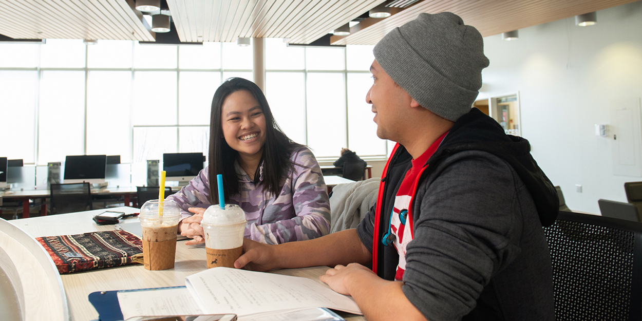 Two students studying in the SIUE student success center.