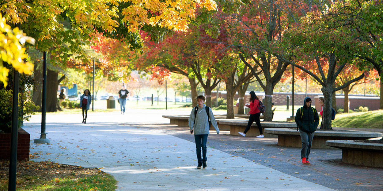 Student Walking on the Stratton Quadrangle on the SIUE Campus.