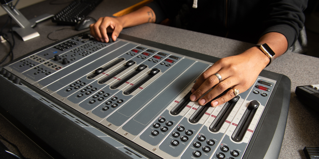 Person working on a sound board at WSIE.