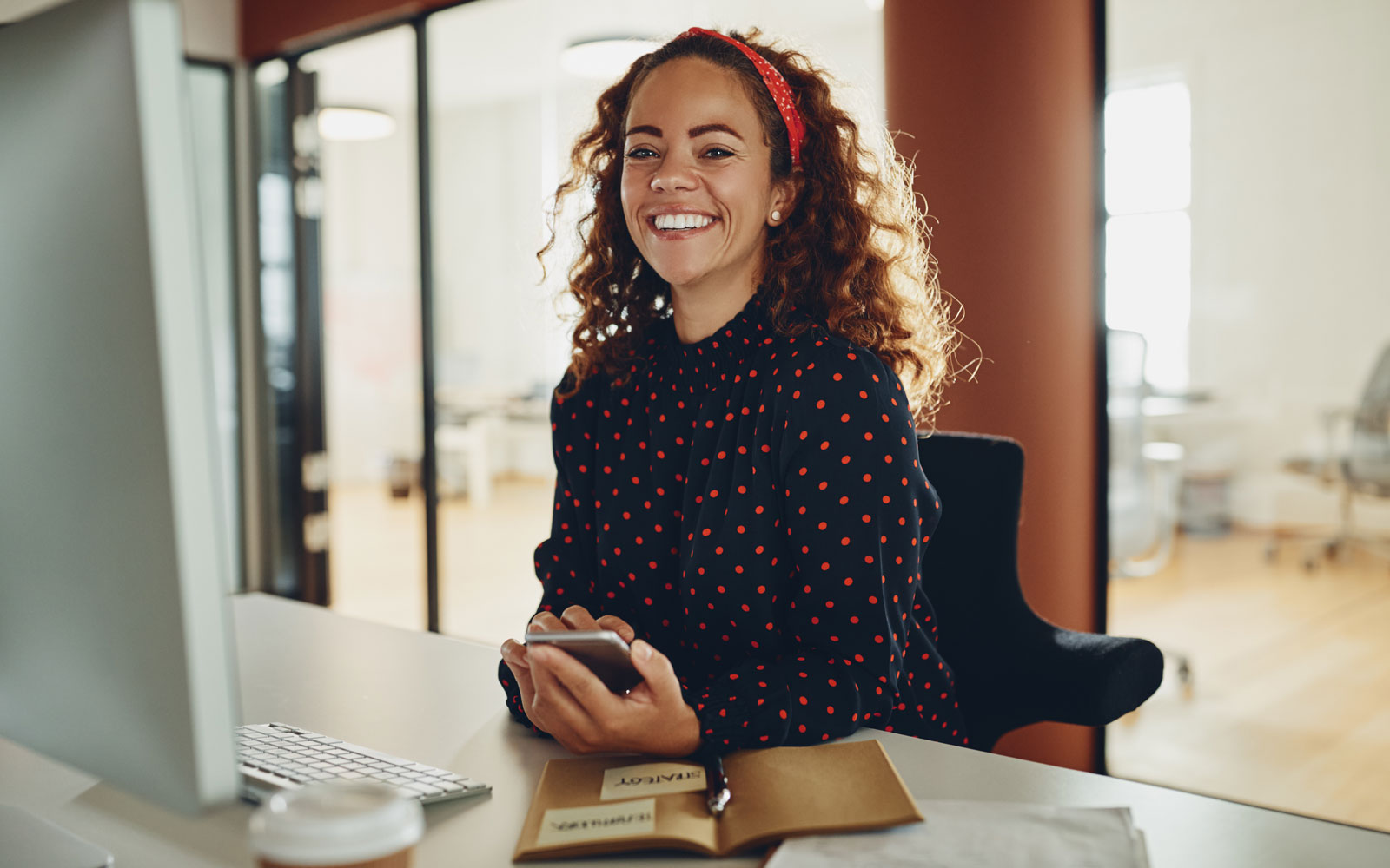 smiling professional woman at desk