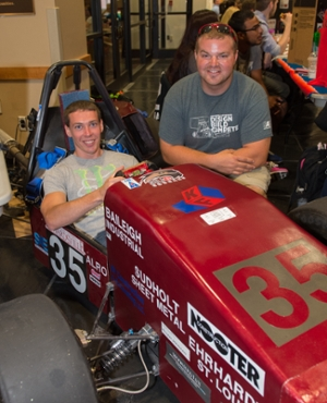 Members of the Formula SIUE organization pose with a racecar they built.