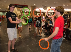 Jugglers demonstrate their talents while gaining the attention of potential new members.