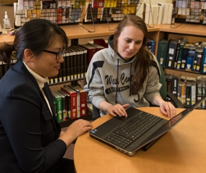 Personal Librarian Sarah Park works with student Elisha Evans