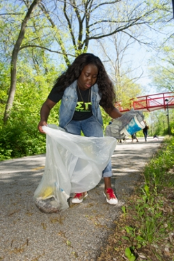 ESG member Love Adantor helps beautify campus on Earth Day.