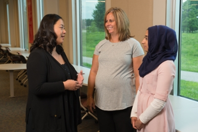 SIUE School of Pharmacy's Dr. Jingyang Fan, Dr. Lisa Lubsch and student Sara Mohiuddin.
