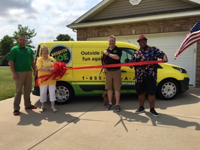 "Mosquito Joe of Madison County owner James ""J.P."" Newcomer and staff cut a ribbon, marking the launch of their insect control franchise."