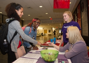 (L-R) Morgan Lowe, a junior accounting major from Belleville, and Chicago native Yaqkeha Witherspoon, a junior studying public health, visit with representatives from the Alzheimer's Association, including intern and SIUE student Emily Kaiser and SIUE alumna Lindy Noel.