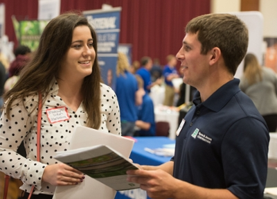 SIUE's Madelyn Diden, a junior majoring in management and marketing, visits with Jesse Humphrey of Byrne & Jones Construction during the October Career Fairs.