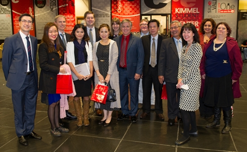 A group of educational leaders from Vietnam pose in SIUE's Morris University Center with School of Engineering Dean Cem Karacal (far left), Chancellor Dr. Randy Pembrook (center), and representatives from ESLi of SIUE and the Offices of International Affairs and International Admissions.