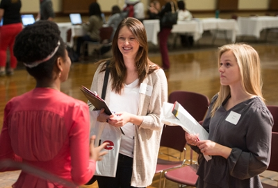 SIUE graduate student Adebanke Adebayo answers questions and offers advice to prospective students Mary Stanfield (L) and Melissa Britten (R).