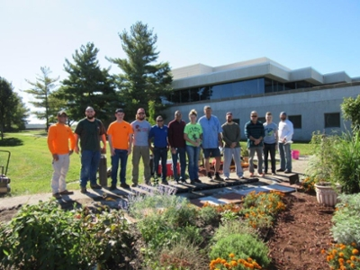 A group of volunteers, including School of Pharmacy Dean Gireesh Gupchup, members of SIUE's Constructors Club, and members of the Rotary Club, installed engraved pavers at the School's Medicinal Garden.