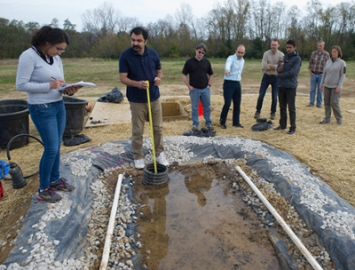 Dr. Abdolreza Osouli, PhD, P.E., assistant professor in the SIUE School of Engineering Department of Civil Engineering, and his team of students discuss their research progress with representatives from IDOT during a tour of the work site on campus.