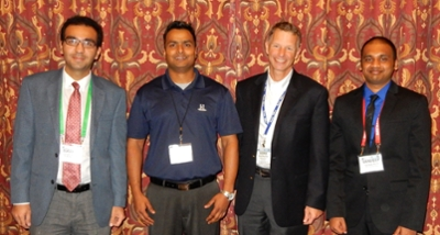 (L-R) Siavash Zamiran, doctoral candidate and GeoConfluence Research Scholarship recipient, Pravin Jha, chairman of the GeoConfluence Research Scholarship Subcommittee, Kord Wissmann, president of Geo-Institute, and Sandeep Goud Burra, scholarship recipient.