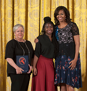 SIUE alumnus Priscilla Block, executive director of St. Louis ArtWorks, and teen apprentice AnnaLise Cason accepted the 2016 National Arts and Humanities Youth Program Award from First Lady Michelle Obama during a ceremony at the White House.