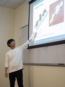 TU student Jongmin Kim presents a portion of his team's senior design project.