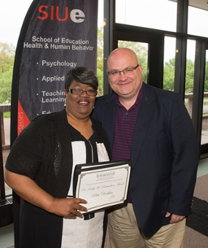 East St. Louis native Rita Doublin earned the Miriam C. Dusenbery Outstanding Student Award and the Dr. Ruth W. Richardson Award. She stands next to SIUE's Dr. Stephen Marlette, associate professor in the Dept. of Teaching and Learning.