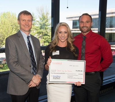 SIUE School of Business Interim Dean Tim Schoenecker stands alongside first place winner of TheOther40 Celeste Hughes and GAINZ by the Dozen co-founder Brennan Malham.