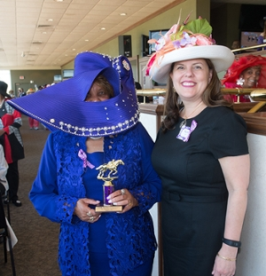 Vice Chancellor for University Advancement and CEO of the SIUE Foundation Rachel Stack (right) stands with SIUE alumnus Jackie Keller Smith (left) who won the biggest hat award for her show-stopping purple hat.