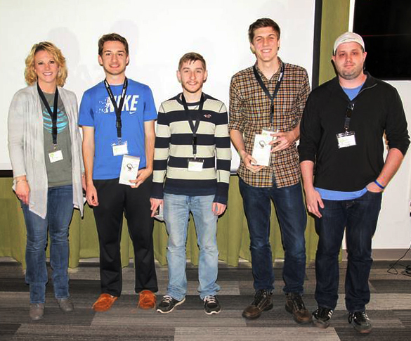 "(L-R) Kim Rakers, of AT&T, with first place winners and ""Photo Code"" creators Thomas Lynch, Daniel Harding and Eli Ball, along with SIUE alumnus Steve Wilkerson, of AT&T."