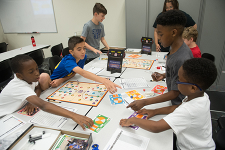 Participants in SIUE's We Got Game: NBA Math Hoops camp work together to enhance their math skills through interactive learning.