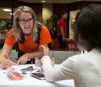Kassie Jeralds, of pre-pharmacy major from Royalton, signs up to learn more about G.I.R.L., a new student organization founded by junior mass communications major Dejanee Callahan.