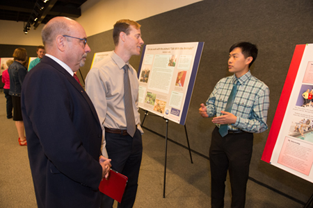 During the Noyce Summer Scholars Showcase Justin Shiau described his summer experience to Paul Rose, PhD, interim dean of the School of Education, Health and Human Behavior (middle), and Greg Budzban, PhD, dean of the College of Arts and Sciences.