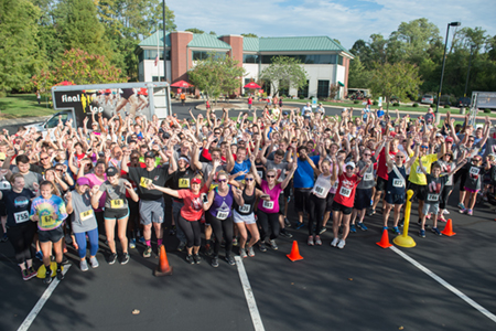 Participants in the SIUE Cougars Unleashed Homecoming Run celebrate the successful event.