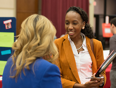 Paula Clarke, of Chicago, gathers information about the master's in business administration during the 2015 SIUE Graduate School Open House.