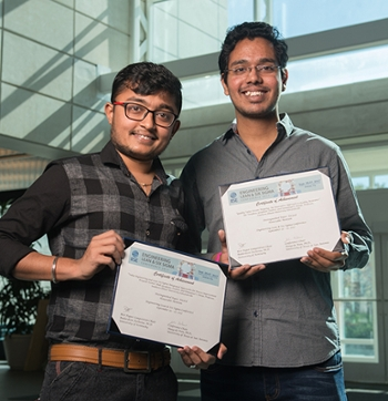 SIUE industrial engineering graduate students Priyank Shah and Jijo Varghese.