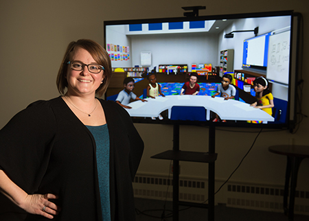 Standing in SIUE's virtual learning environment is Anni Reinking, EdD, assistant professor in the School of Education, Health and Human Behavior's Department of Teaching and Learning.