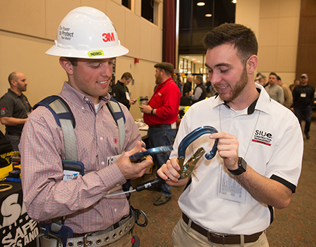 SIUE senior construction management majors and members of the School of Engineering's Constructor's Club (L-R) Drew Westerhold and Cody Kruse check out safety equipment during the SIOSH/SafetyCon event held at SIUE.