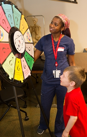 JaTerra Castine-Ross, a third-year SIU School of Dental Medicine student, leads an educational station during National Children's Dental Health Month.