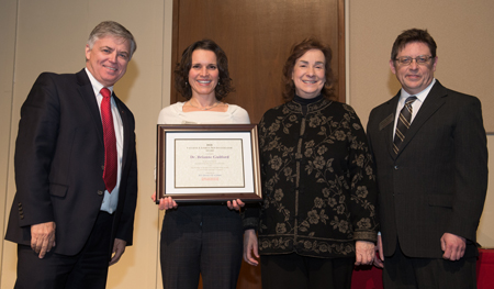 (L-R) SIUE Chancellor Randy Pembrook, 2018-19 Vaughnie Lindsay New Investigator Award recipient Dr. Brianne Guilford, Sandy Doreson, daughter of the late Dr. Vaughnie Lindsay, and Dr. Jerry Weinberg.