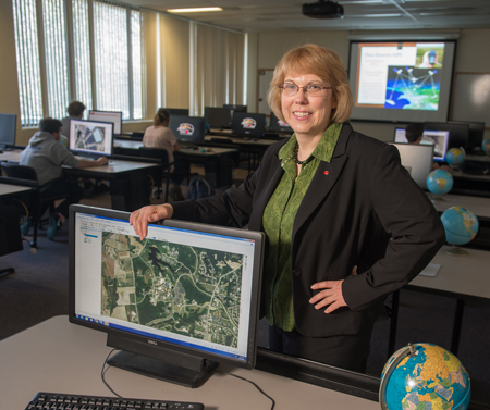 SIUE College of Arts and Sciences Department of Geography Chair Susan Hume, PhD, stands in the University's Geospatial Technology Lab.