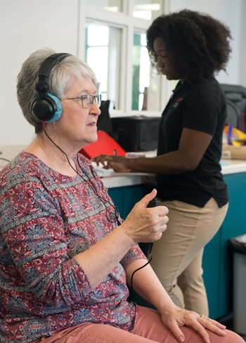 Karen File had her hearing screened by SIUE speech-language pathology graduate student Jenee' Brown.