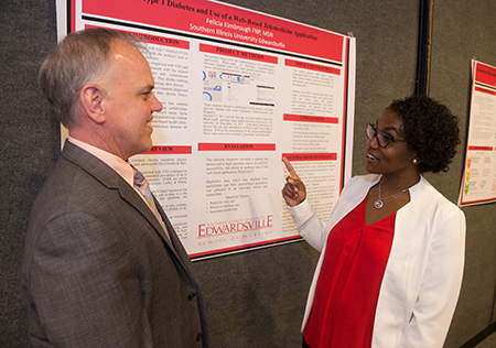 SIUE School of Nursing DNP program graduate Felicia Kimbrough presents her practice project to Assistant Dean for Graduate Programs Andrew Griffin.