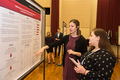 SIUE School of Pharmacy's Maddie VanDaele presents her research at an SIUE event.