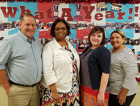 (L-R) SIUE's Brian Johnson, PhD, stand alongside Gordon Bush Elementary's Carmalita Neely, SIUE senior Abigail Cline, and Gordon Bush Elementary's Gloria Oggero.